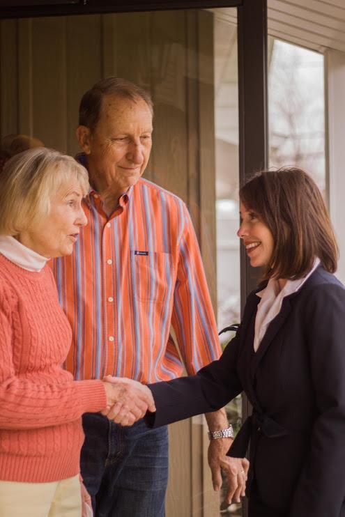 shaking hands at door 2